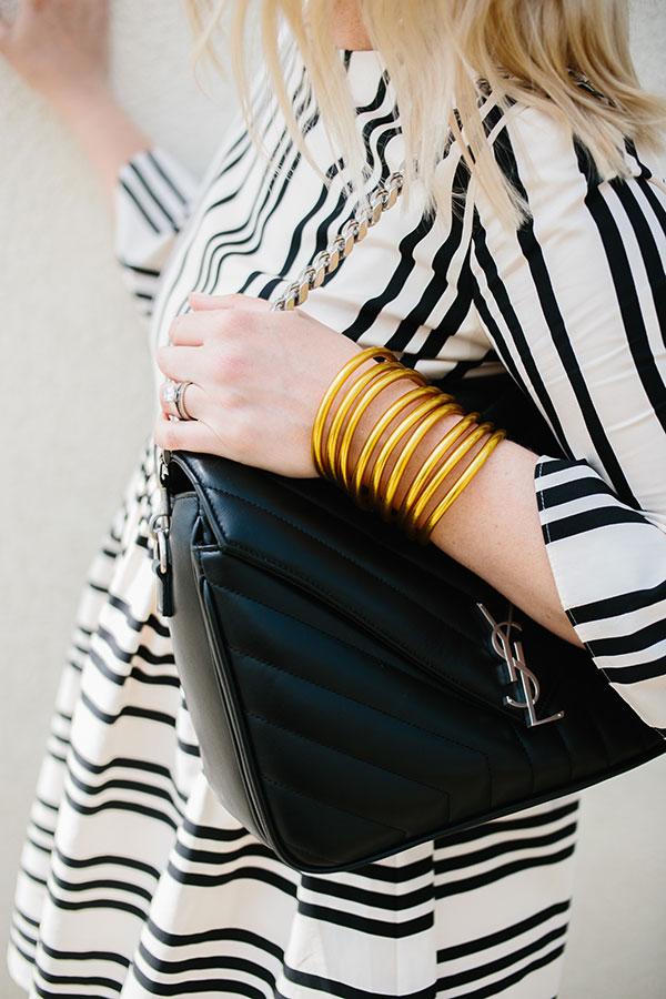 Gold bangles with black YSL bag and black and white stripe dress I waitingonmartha.com