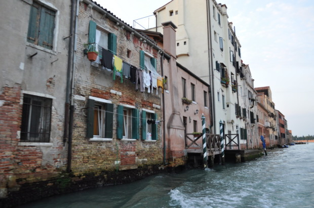 Traveling past homes in Venice into the center of the city