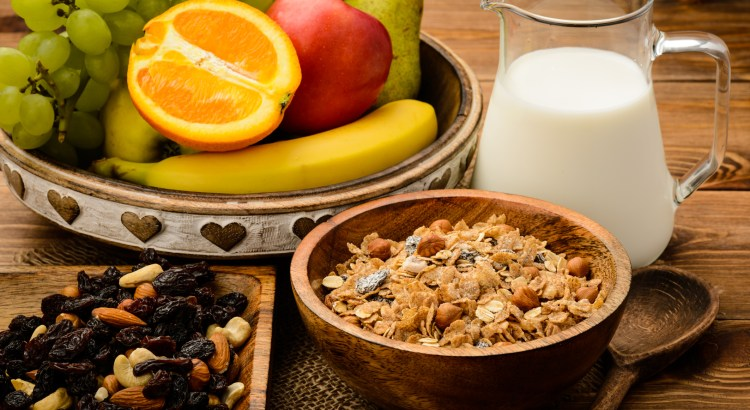 Healthy breakfast with muesli, milk, fresh fruits and nuts.