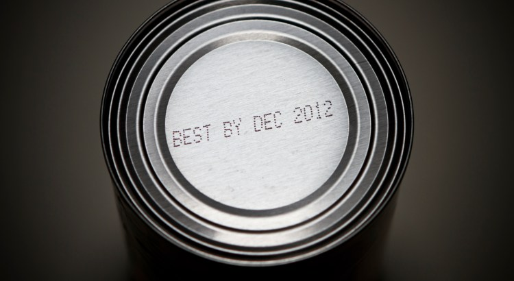 "A 2012 ""End of the world"" concept image with the idea that non-perishable canned foods need to be stockpiled just in case of the Mayan calendar predicted apocalypse on Dec 21st 2012. And, conceptually, that the world has an expiration date, and is ""best used by December 2012"". The product ""use by date"" is real; not added in Photoshop."