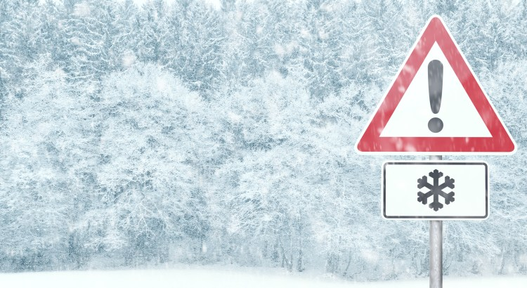 Snowy landscape with warning sign and copy space