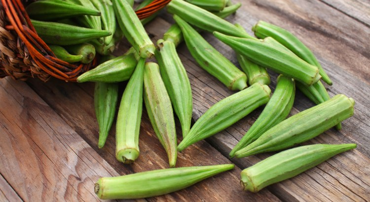 Lady Fingers or Okra over wooden table background