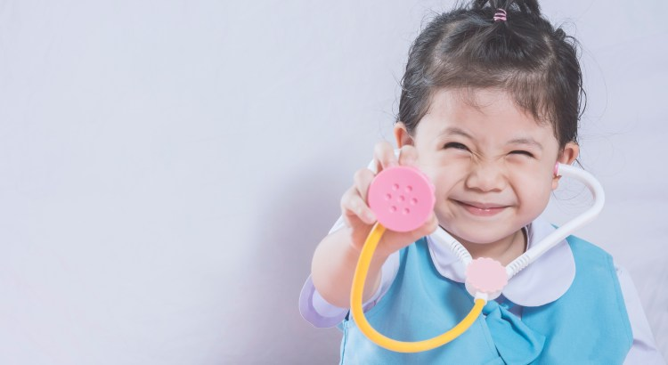 Little Asian Girl and Stethoscope toy with Doctor concept copy space.