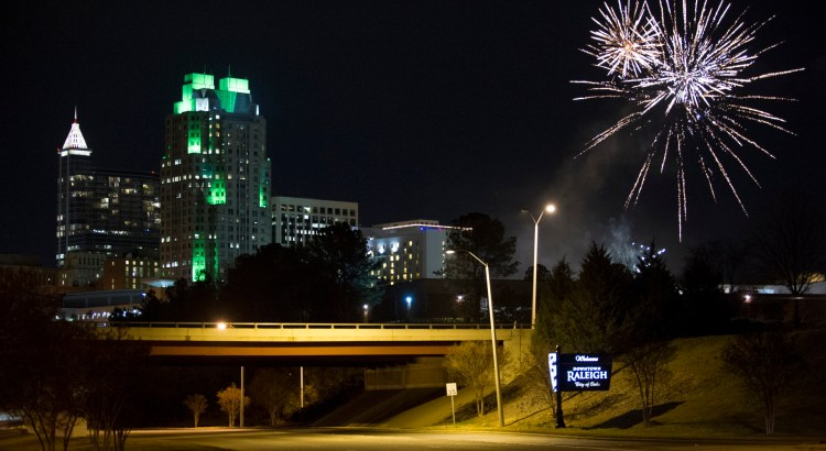 Fireworks explode over the skyline to celebrate New Year's Eve in Raleigh, North Carolina.