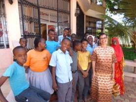 Elimu president with students ERC main door