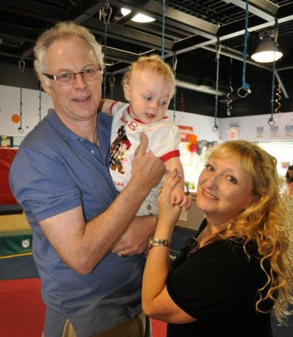 The parentals with D at his first birthday party