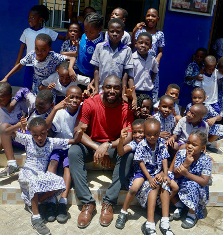 Isaac visiting the school that he volunteered as a teacher for in Ghana.