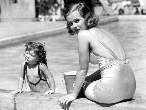 Joan Bennett and daughter Melinda enjoy a sunny day at the El Mirador Hotel, Palm Springs. June, 1936