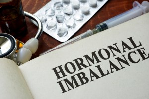 diagnosis of hormone imbalance on paper on desk
