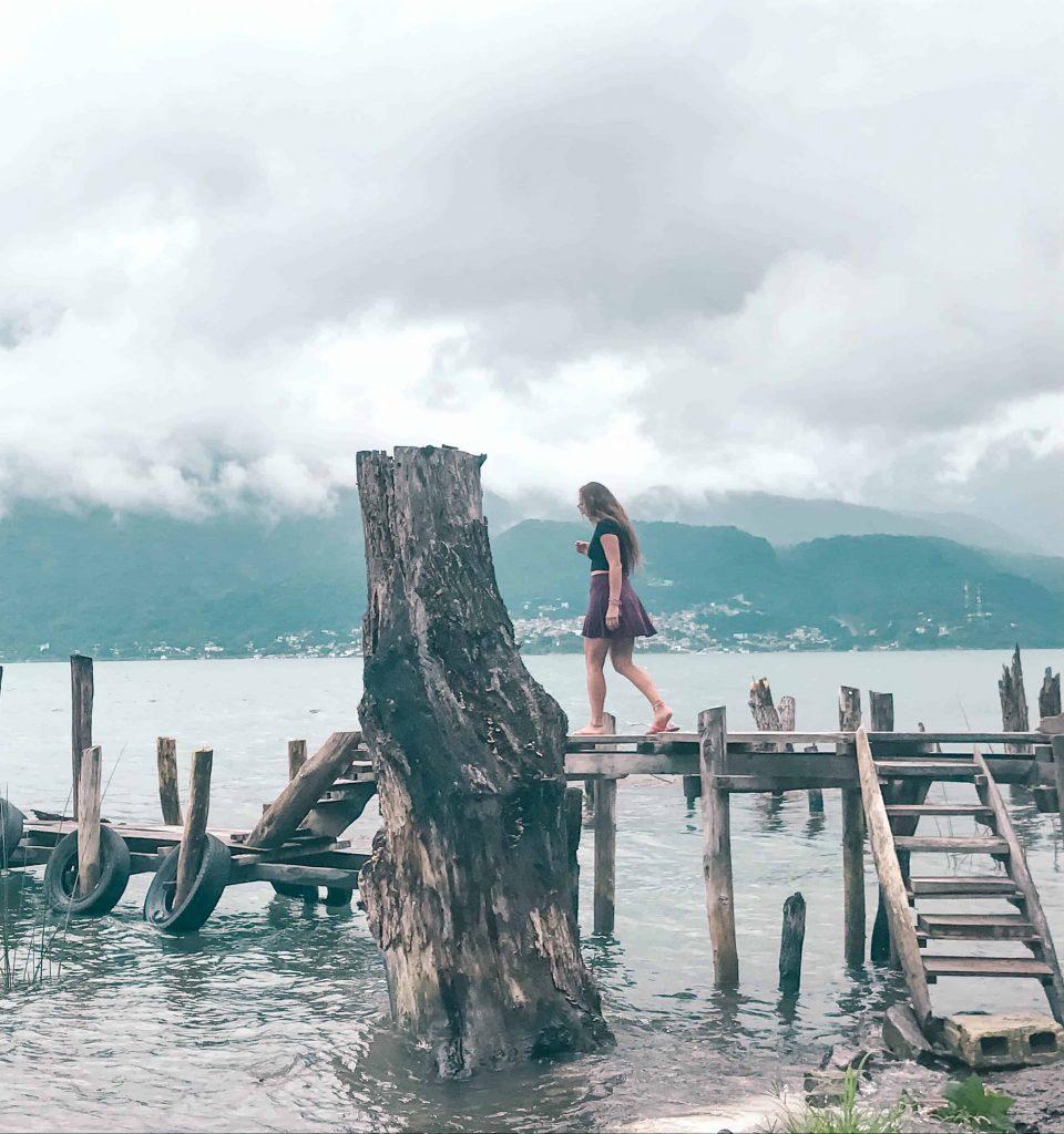 Walking down the crooked docks of lake atitlan