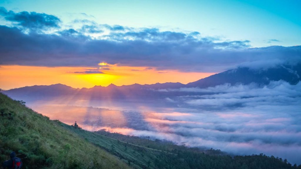 Climbing mount Batur in Bali at sunrise