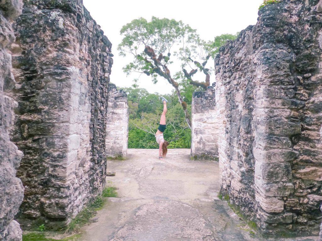 handstand on tikal ruins