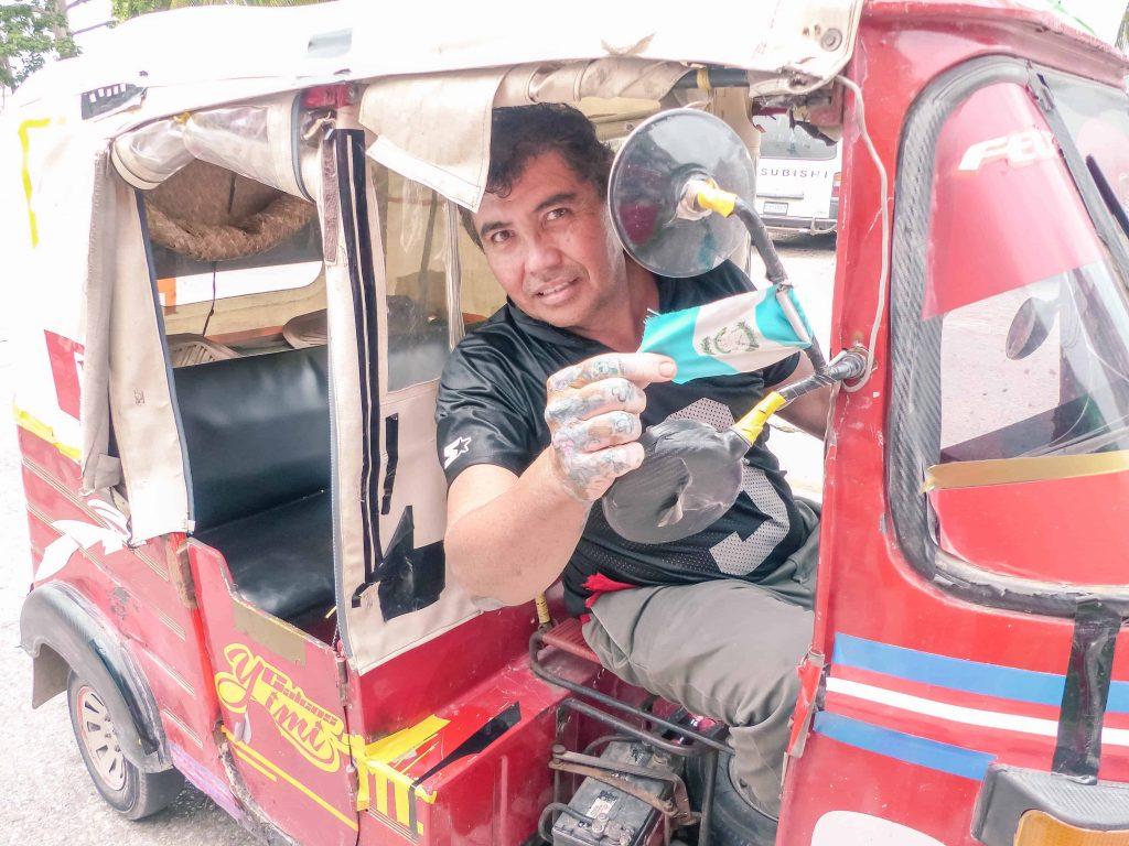 a tuk tuk driver in flores guatemala
