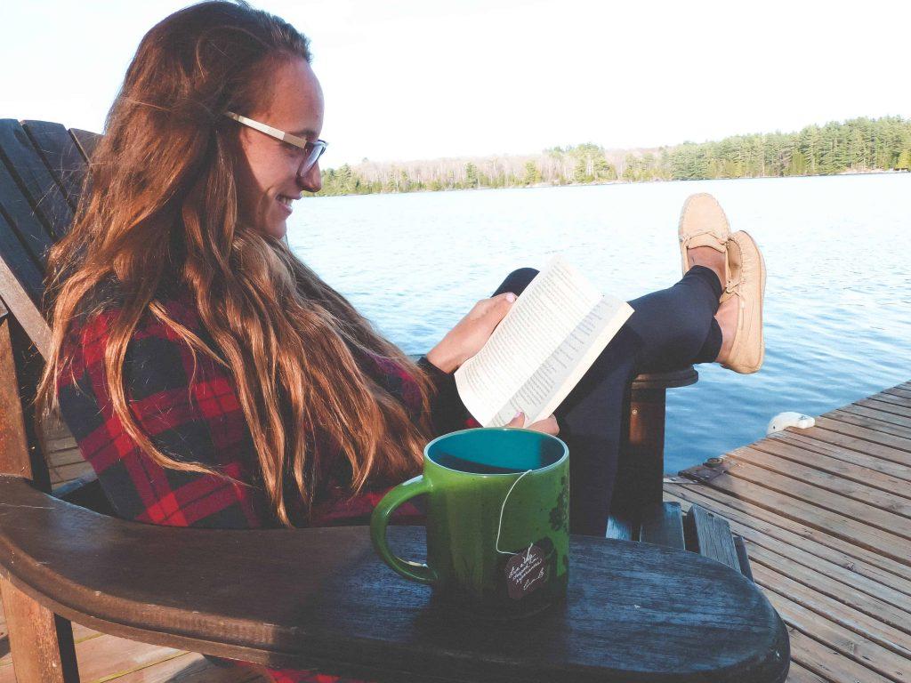 drinking bigelow steep tea on dock while reading celebrating #victoriadayweekend #teaproudly