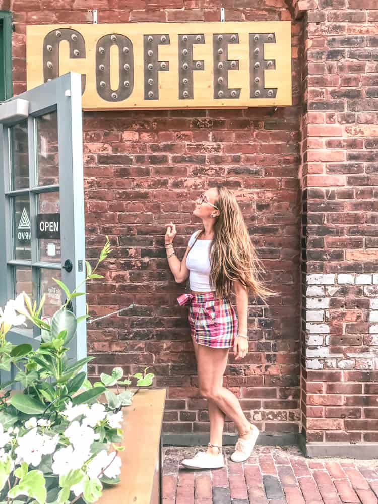 standing out front of arvo coffee one of the best coffee shops in Toronto in the historic distillery district of Toronto