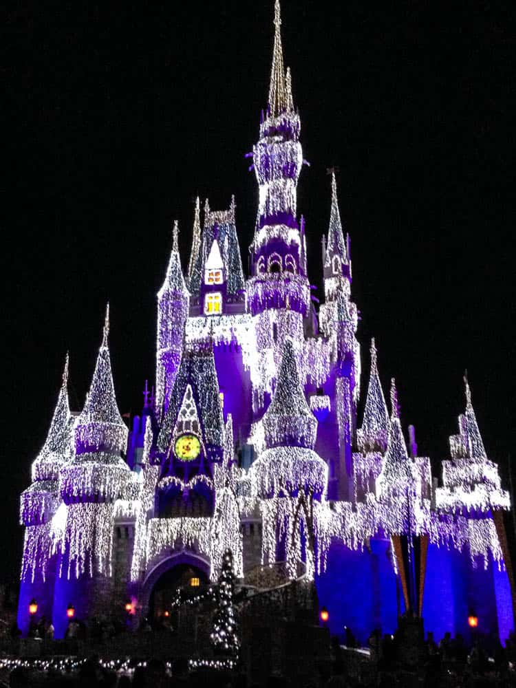 a kiss goodnight at magic kingdom on cinderella castle