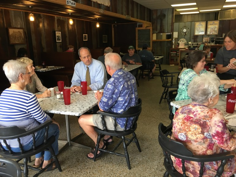 Commissioner Whitfield at Susan's Diner talking with folks