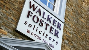 Main walker foster sign above main entrance