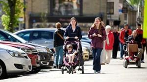 family walking down high street
