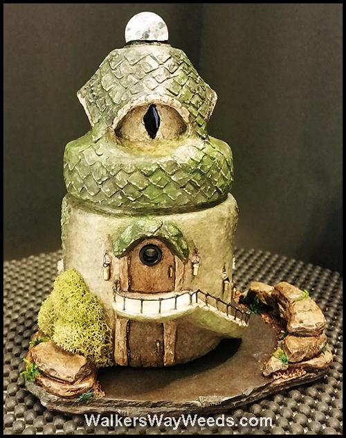 Rear of Dragon's Eye Den on stone base
