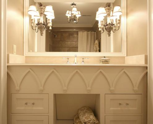 elegant bathroom,decorative trim,glass drawer pulls,vanity