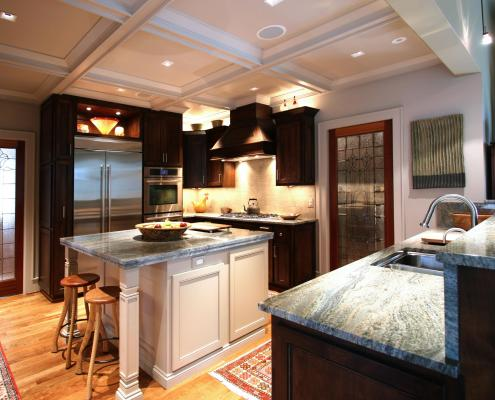 kitchen,small kitchen,two toned cabinets,seating area,simple tile back splash