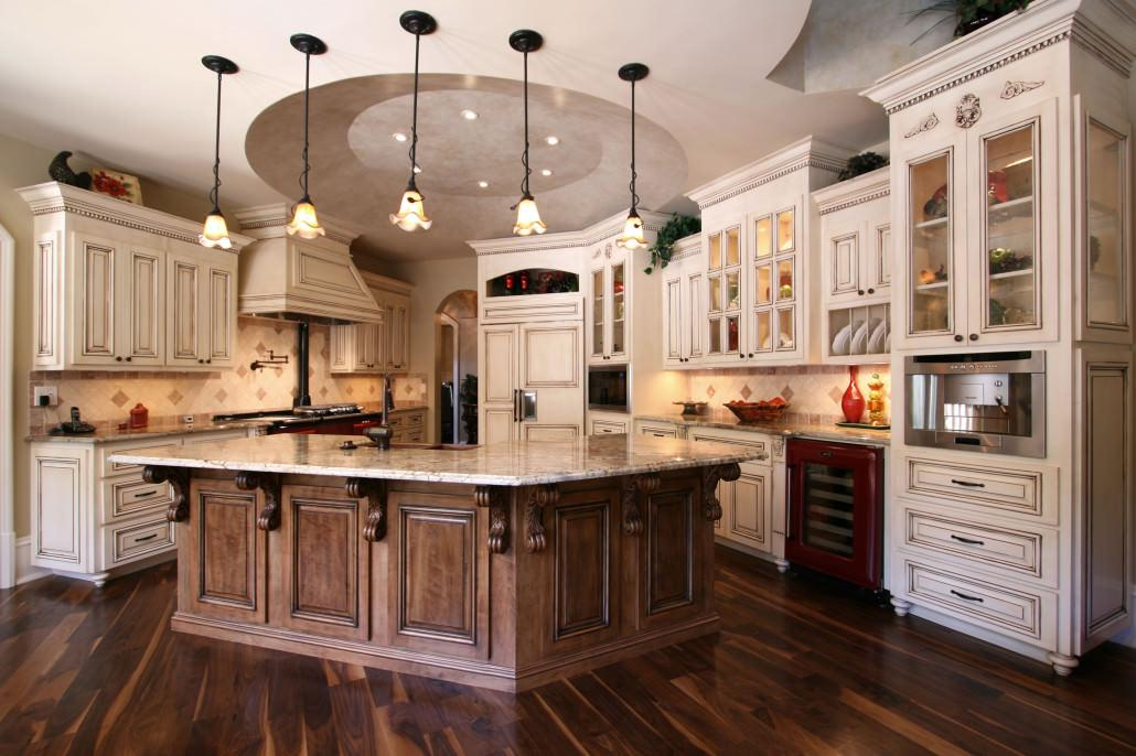 Custom Cabinets by Walker Woodworking. This beautifully styled french country kitchen has many elements of character. The custom hood, egg and dart trim accompanied by the glass front cabinets give this kitchen the feel of warmth and welcome! Photo by Walker Woodworking Staff - All Rights Reserved.