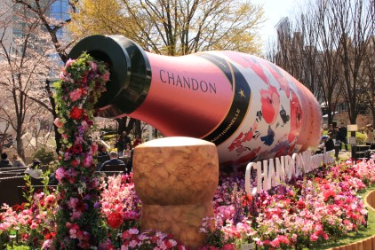 Flowers are pouring from the bottle of champagne.