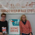Authors Poggioli-Eidson-with an SF 49 mile seagull sign