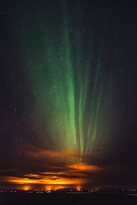 Aurora Borealis Steaky Over Light Pollution Iceland