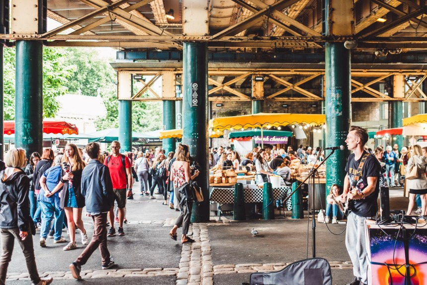 London Itinerary Borough Market Covered Food Stalls and Busker