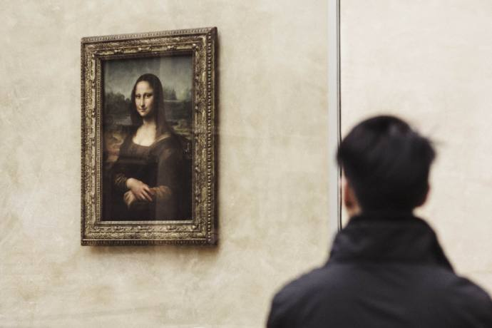 Man looking at the Mona Lisa