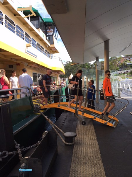 Passengers disembarking from an Inner Harbour ferry at Balmain East