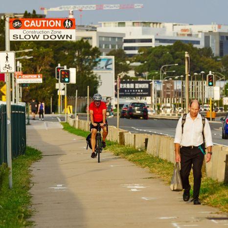 man cycling man walking