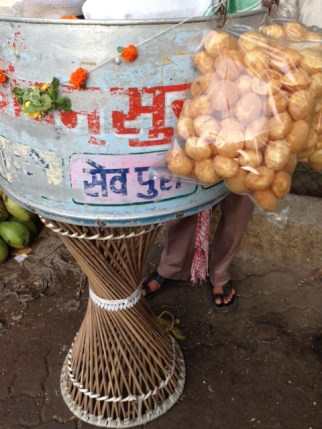 Conical stand with bags of puri
