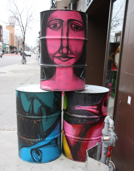 Painted Labrona pieces on barrels in front of HoMa barrels