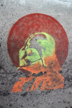 stencil by Graffiti Knight on sidewalk in alley between St-Laurent and Clark