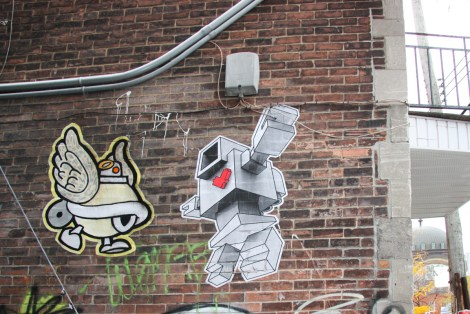 Lovebot and Turtle Caps wheatpastes in alley behind St-Laurent on the corner of St-Viateur