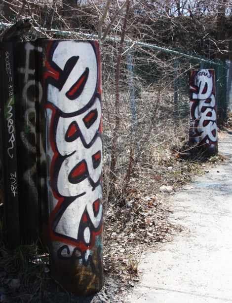 Deep graffiti on posts next to the Rouen tunnel legal wall