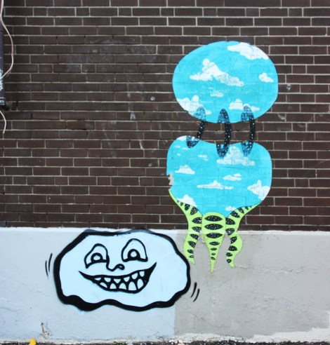 wheatpaste by Swarm on the right and small painted piece by Timmy Drift bottom left