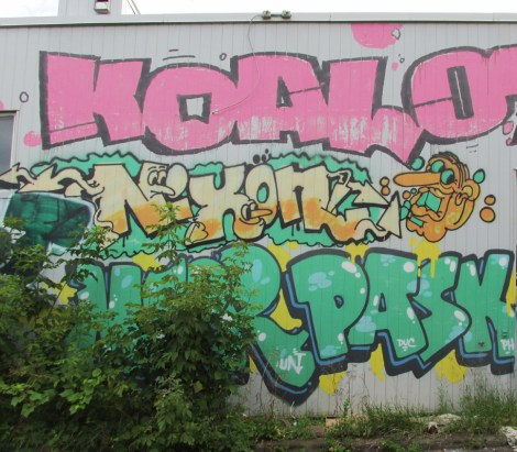 Graffiti by Koal, Nixon and Pask on back of business on Sherbrooke in HoMa