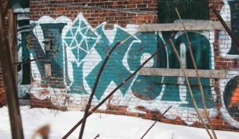 Nixon graffiti near Jeanne-d'Arc and Notre-Dame in HoMa