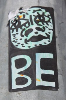 Sticker by unknown artist in alley between St-Laurent and Clark