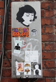 Paste-ups and stickers by Bird (top), ROC514 and Sien514 (pumpkins), Swarm (right of pumpkins), Waxhead (bottom left), Turtle Caps (bottom centre) and Fortin Marchand (bottom right) in alley between St-Laurent and Clark