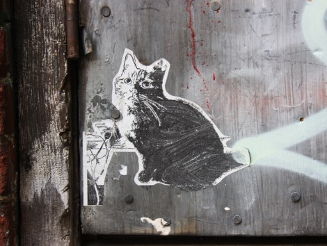 Wheatpaste by unknown artist in alley between St-Laurent and Clark