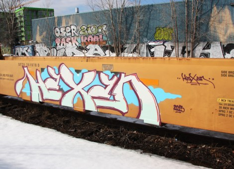 Graffiti by Haxar on parked train. Also visible is graffiti by Oser, Zion, Pask, Koal and Fost.