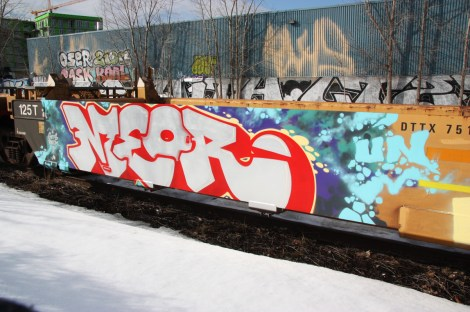 Graffiti by Meor on parked train. Also visible is graffiti by Oser, Zion, Pask, Koal and Fost.