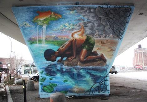 Monk.e 'mural' on a pillar of the Van Horne|Rosemont overpass