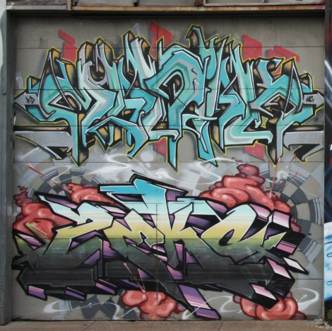 Maniak (top) and Zek (bottom) graffiti on garage door on Cabot