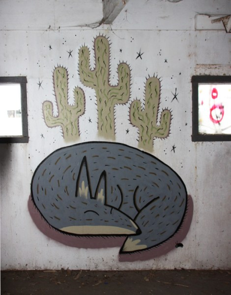Unknown artist in an abandoned building